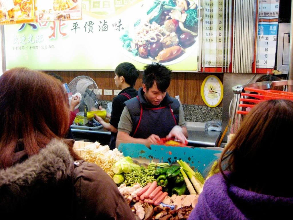 Grabbing a bite in Shida Market