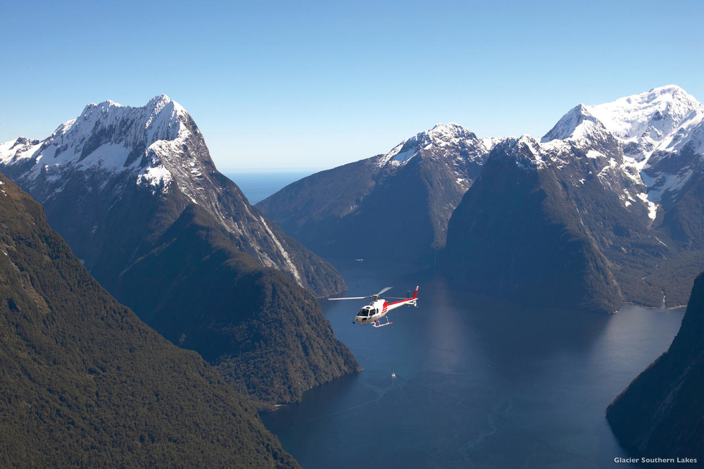 Explore the dramatic scenery of the Fiordland National Park by helicopter, a popular Queenstown day trip. Photo: Glacier Southern Lakes Helicopters.