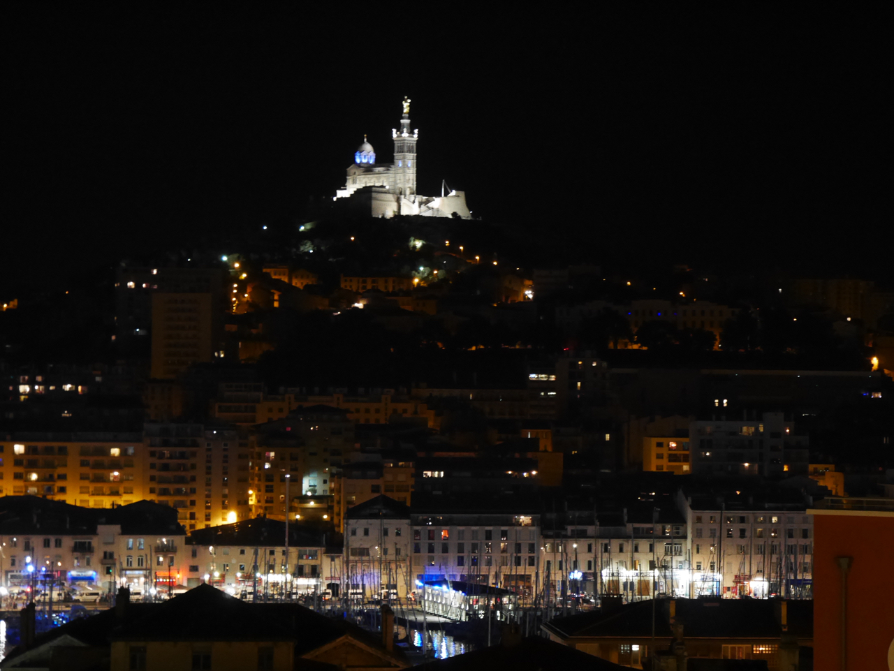 Illuminated Notre Dame de la Garde and Vieux Port at night