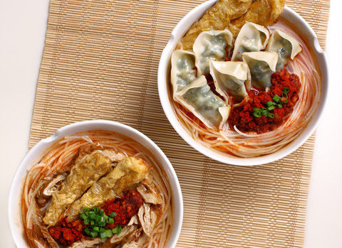 Nam Kee's one-pot noodles with spring rolls and dumplings