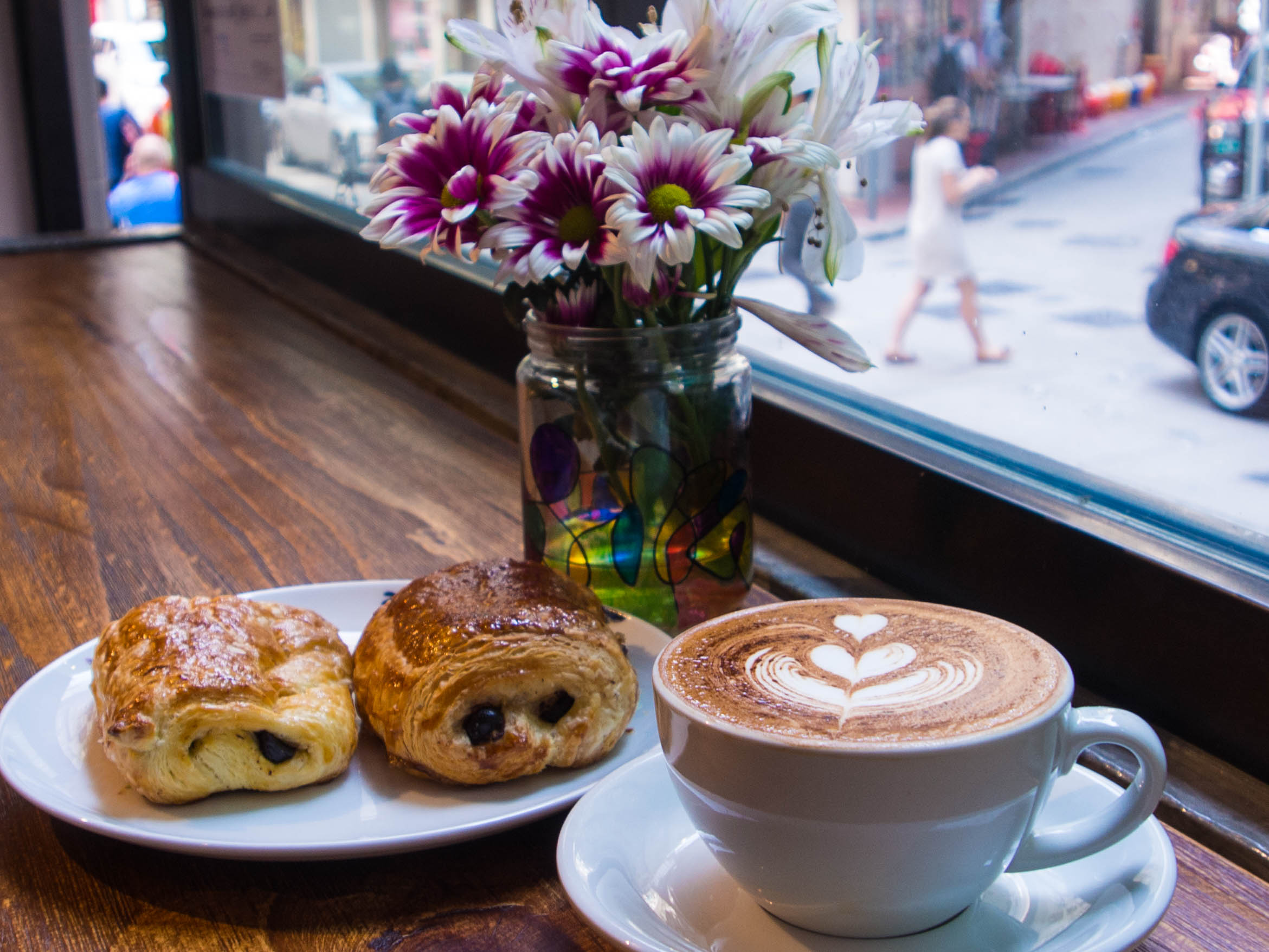 Why50 cappuccino and croisant.