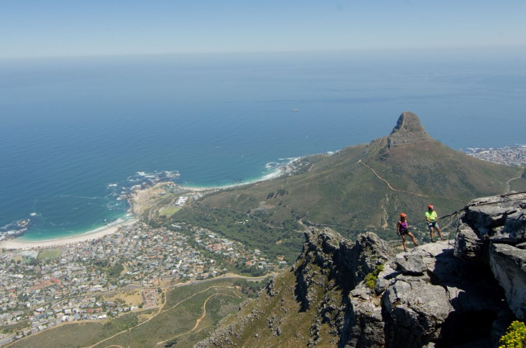 Couple abseiling off the cliffs of Table Mountain