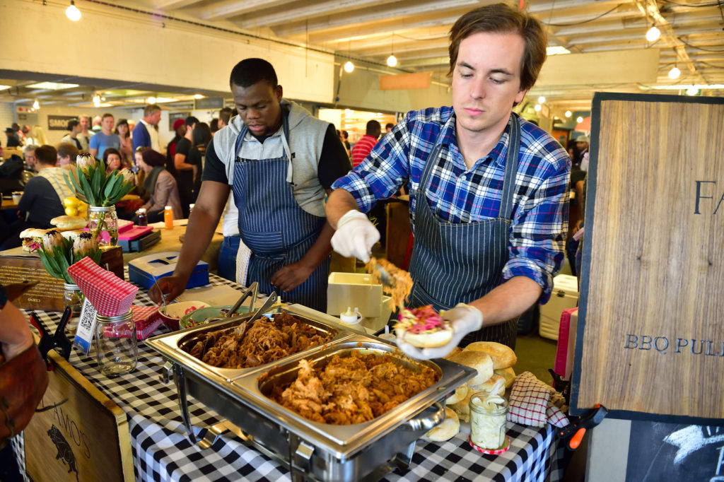 Vendors serving food at Neighbourgoods market