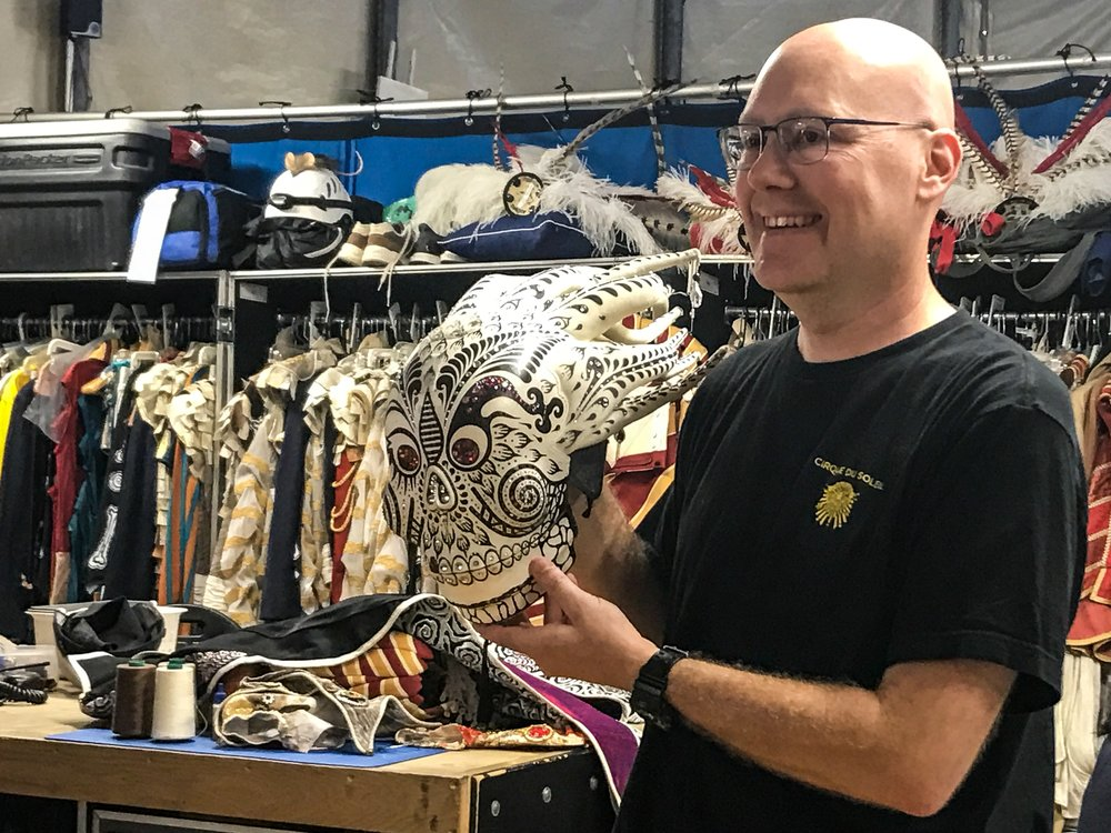 Greg Peyton shows off part of Kooza's most expensive costume in the costume tent. Photo: Gayatri Bhaumik