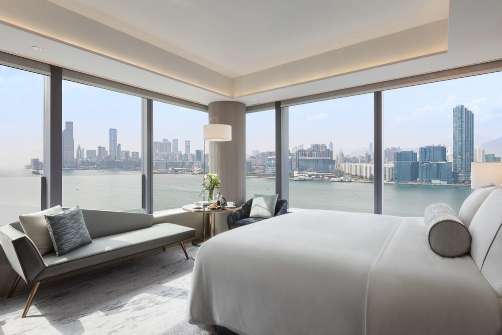 The Deluxe Harbourview rooms at Hotel VIC on the Harbour boast stunning views of the Kowloon skyline.