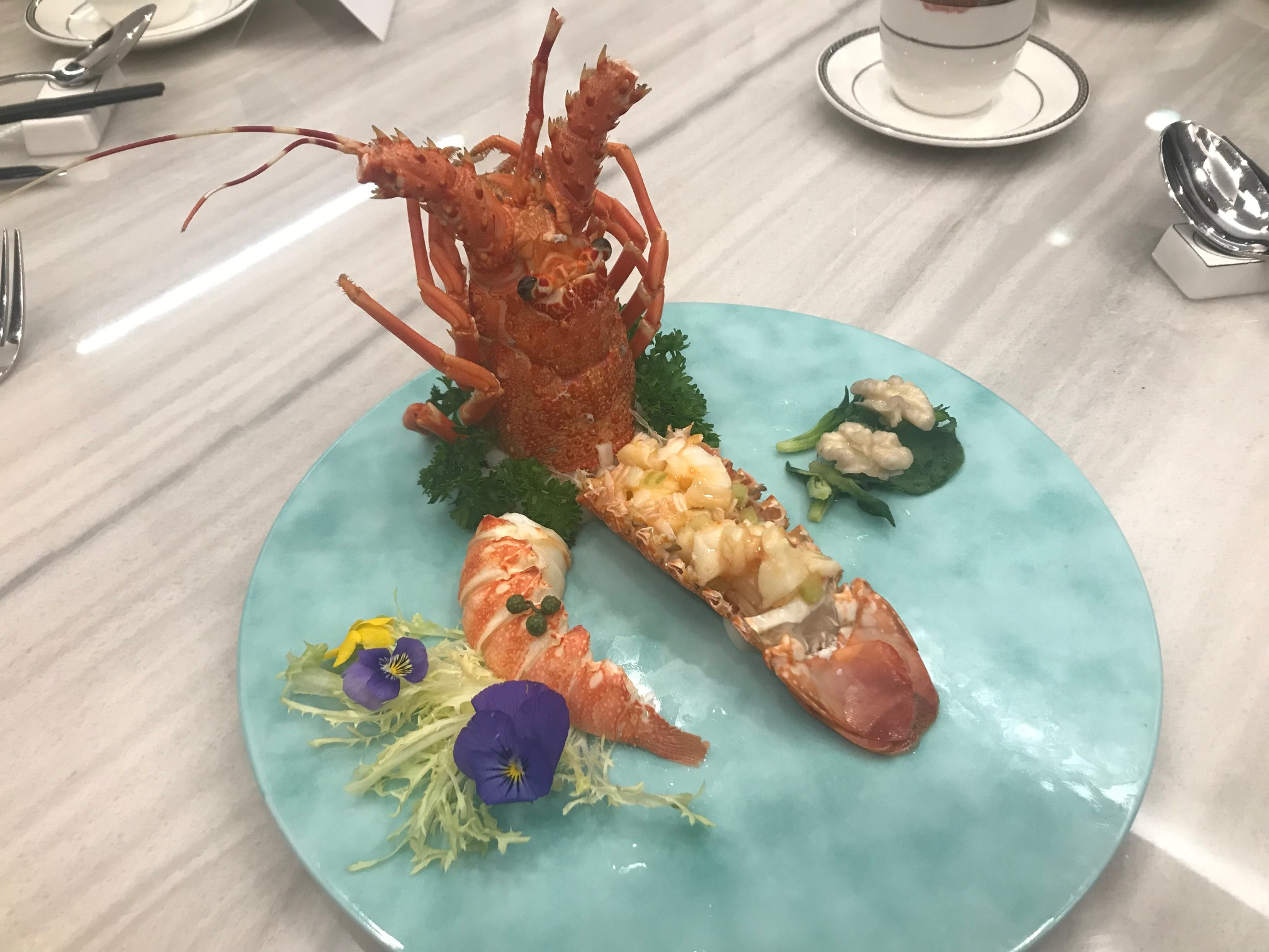 Lobster two ways with Sichuan spicy sour sauce and Thai sweet sauce served with Ficoïde Glaciale