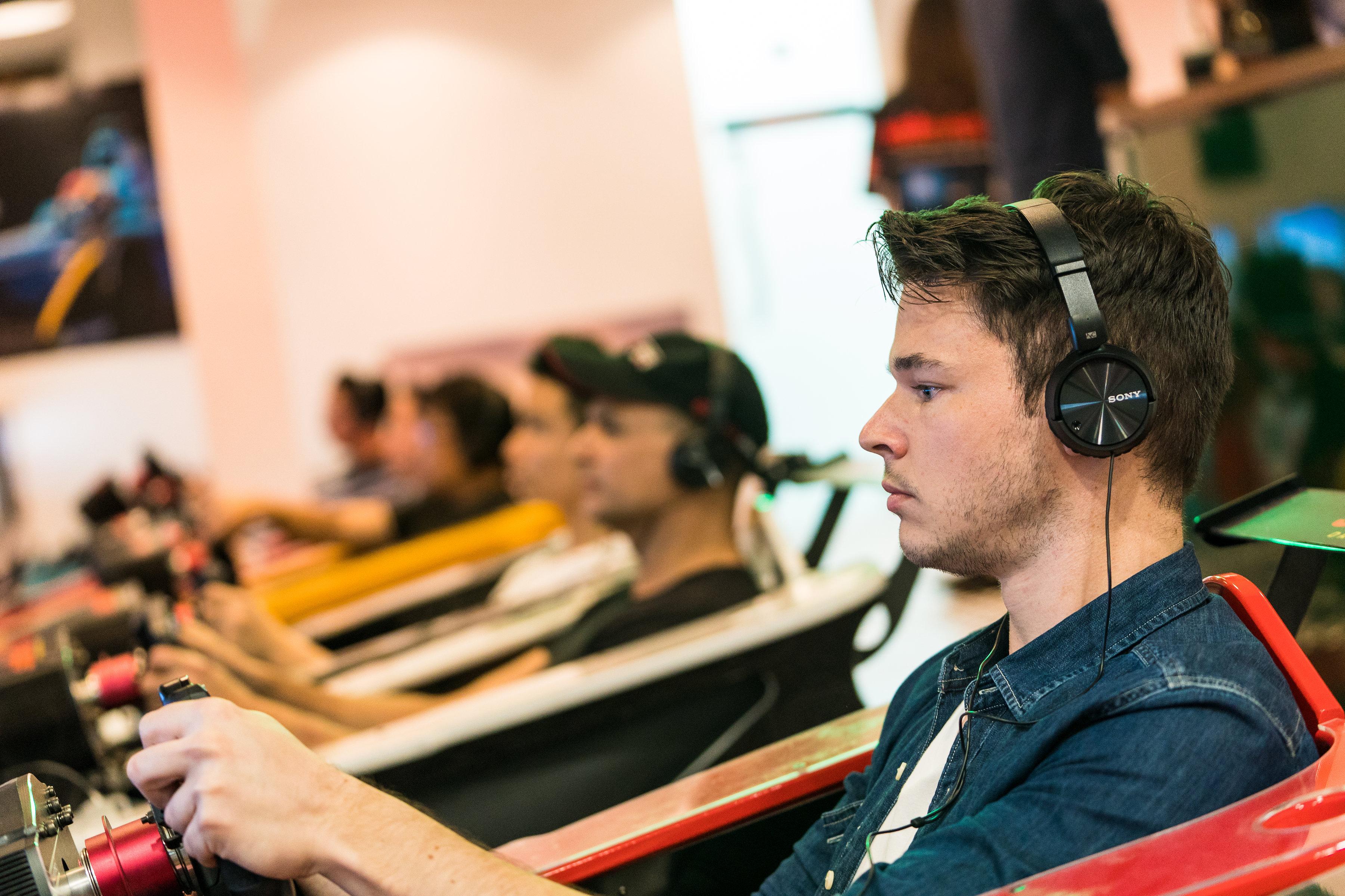 Black Arts Racing driver Dan Wells has a go on one of Sideways Driving Club's simulators.