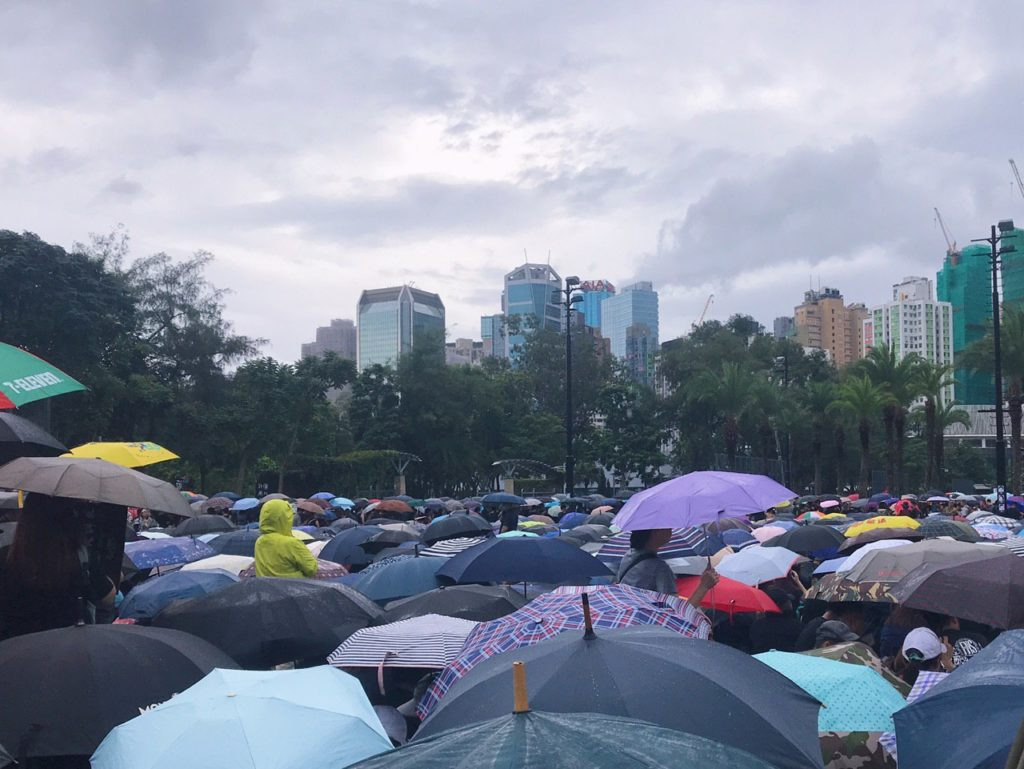A rally during a rainy day at Victoria Park.