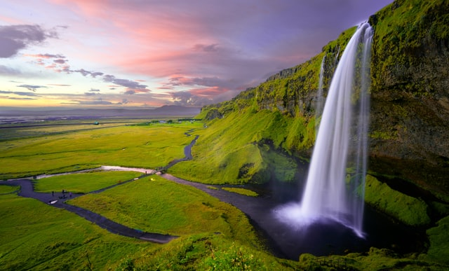 visit the stunning waterfalls during a solo trip to Iceland