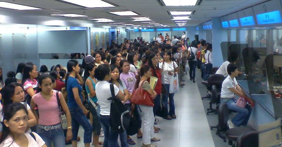 Foreign domestic helpers line up to renew their contracts (Photo Wikimedia Commons)